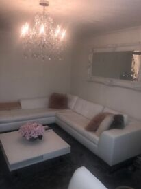 White leather corner sofa and matching chair