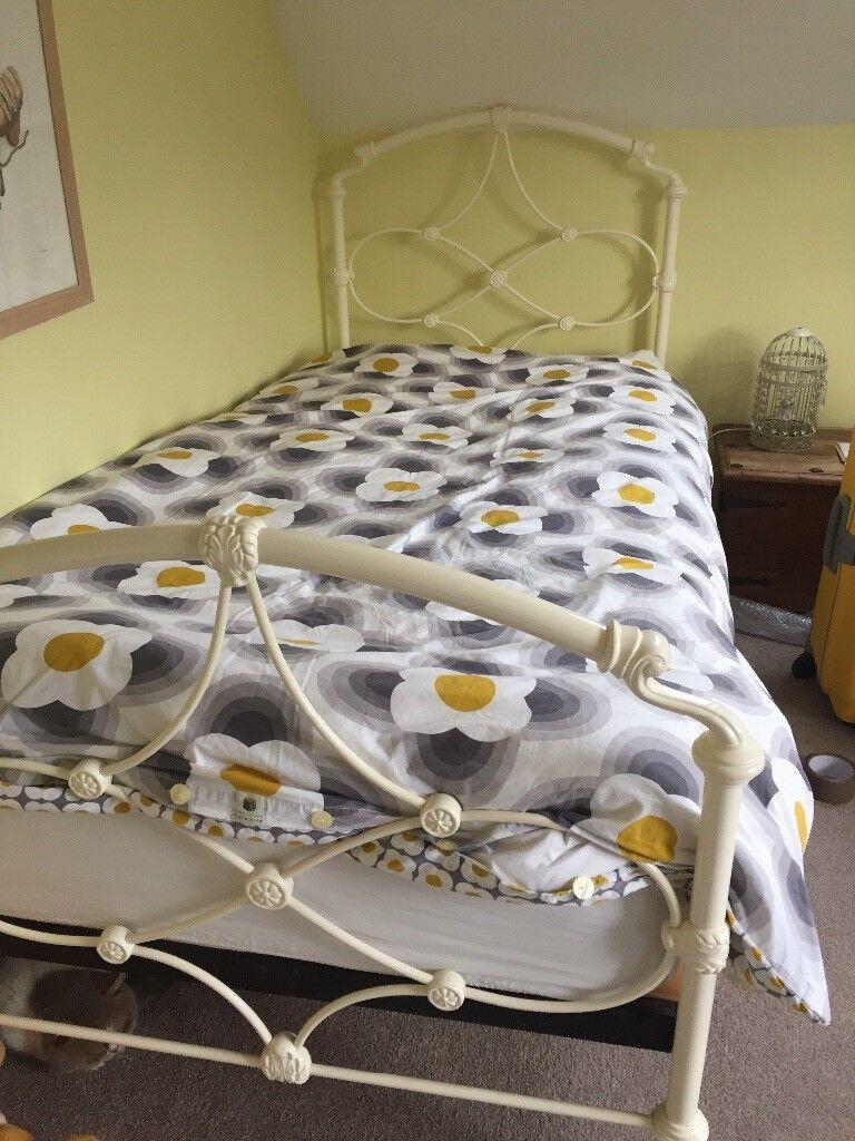 White/cream metal single bed