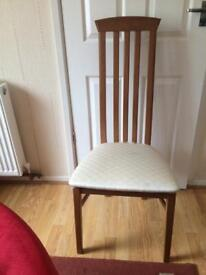 Extending oval dining table and six high back padded chairs