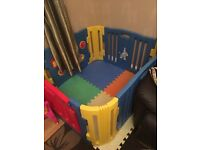 Large playpen with mats and activity part