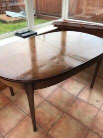 Wooden extended dining table and 6 chairs