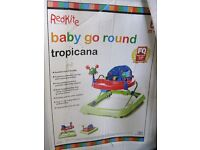 NOT USED bABY GO ROUND TROPICANA WALKER !!