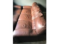 Three seater leather couch x2