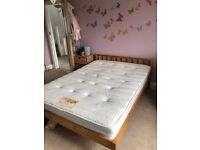 Solid wooden double bed frame for sale.