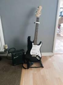 Rockburn electric guitar, amp and strap