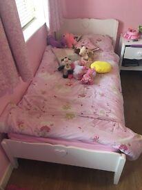 White wooden single bed love heart design