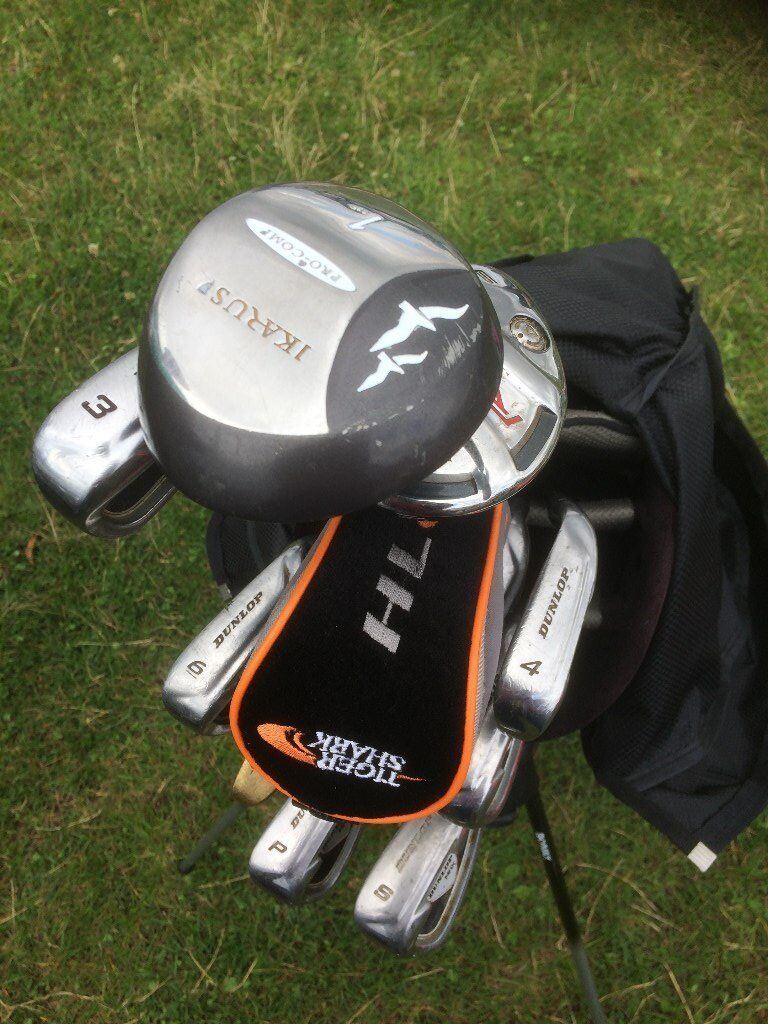 golf clubs and bag including stand