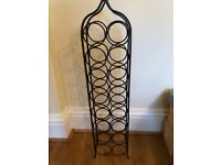16 Bottle freestanding, metal wine rack ,with dark wooden handle.