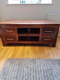 Dark solid wood TV unit with storage draws