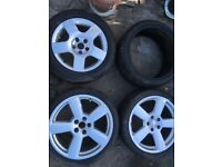 Three alloy wheels with tyres and one extra tyre