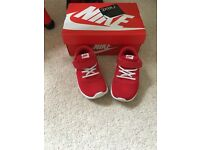 Red Nike roshe trainers boy size 8