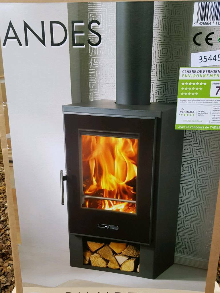 """Wood burning stove 8kwin Kinross, Perth and KinrossGumtree - Modern contemporary stove 8 kw, panadero make, with wood storage space. Made in Europe good quality stove new in box Height 33 Depth 15"""" Width 19"""" flue 6"""" , very nice fire 07849586723"""