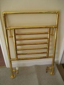 Solid gold towel rail