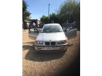 Silver BMW very low mileage. All service history