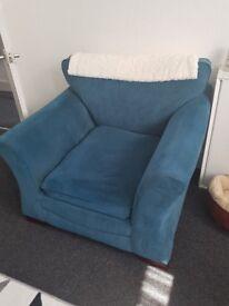 Teal coloured armchair