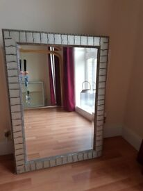 Silver painted wooden framed wall mirror.