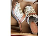 Brand New with tags. Slip on heeled shoes, floral design