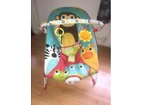 Baby bouncer with song and vibrate function