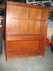 teak bookcase in excellent condition, three shelvestwo encased by removable glass doors