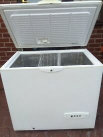 MEDIUM SIZE WHIRLPOOL CHEST FREEZER IN GOOD WORKING CONDITION.