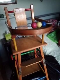Old dolls high chair converts. In original condition. Ideal to display special dolls or teddies