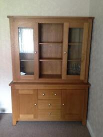 Large oak effect unit with glass panel doors, shelves and drawers. Living room/dining room furniture