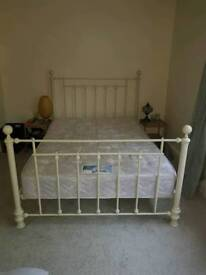 Light, off white double bed