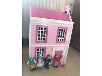 Wooden dolls house with wooden people and furniture