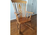 wooden rocking chair - perfect for nursery or living room.