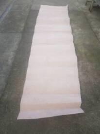 "Off-cut cream carpet 12f long by 29"" wide"