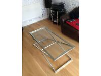 John Lewis coffee table - silver framed with see-through glass top. Dimensions - 112cm by 52cm