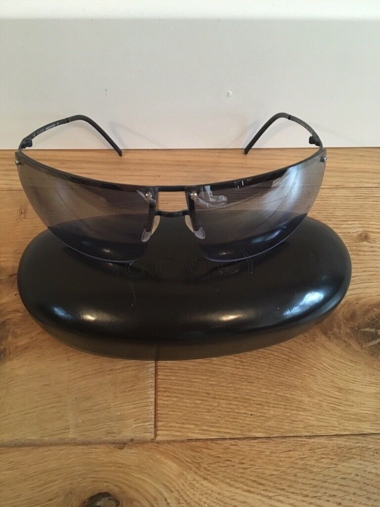 Beautiful genuine Gucci sunglasses with original case. Lenses have a blue tint
