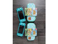 TWO Nintendo Switch Lite Consoles.. TWO Animal Crossing Games & TWO Animal Crossing Cases..