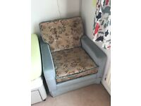 Two upholstered arm chairs and foot stool