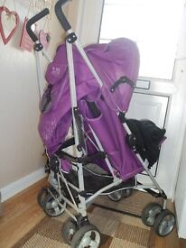 Purple Zeta Voom pushchair. cosy toes and raincover.