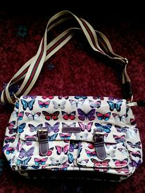 Ladies bag. Butterfly design. Lots of internal zipped pockets.