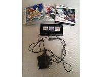 Nearly New Black Nintendo DS Lite with 3 Games and unopened 4Gamers Essentials Pack