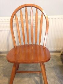 Three matching solid wood chairs