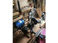 Woodworking lathe. Rotates 90 degrees to accommodate larger pieces for bowl turning.
