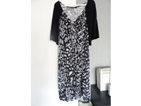 LADIES BLACK MULTI DRESS WITH ATTACHED SHRUG.