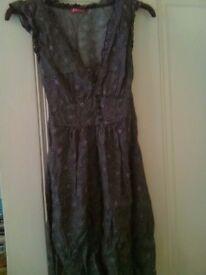 Sleeveless tunic size 6