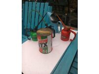 3 oil cans , 1 oil jug plus 1 very old unopened tin of Castrol gtx oil