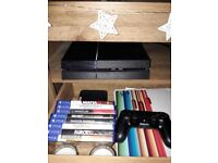 Playstation 4 console with 8 games.