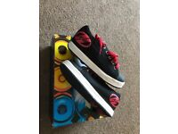 Boys black Heelys trimmer with red boxed VGC size 3(35)