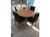 Ikea Round Wooden Extendable Table with HENRIKSDAL leather chairs
