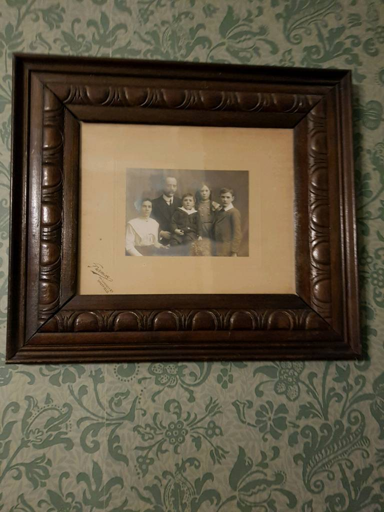 Two vintage family portraits