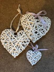 3 white wicker hearts