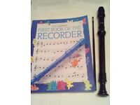 An Aulos Descant Recorder with Usborne book of the recorder