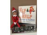 Elf on the shelf with paperback book