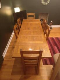 Solid wood dining table and 8 chairs.